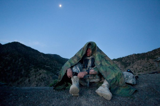 Chad Hunt, Medic under moonlight, Cpl Caleb Pacheco, 3-509 US Army Airborne Medic, on a 3 of 5 day mission with the 3-509 Army Airborne Geronimo Scouts, Paktika Province, Town of Kalay, Afghanistan