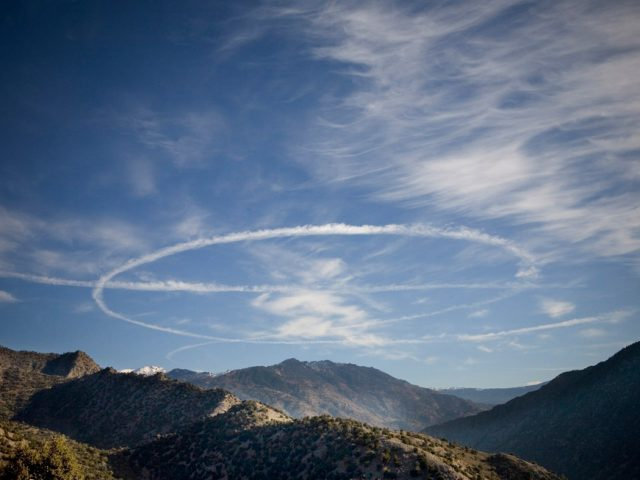 Chad Hunt, F-15 fighter plane on station, circling over the Korengal Valley, The Korengal Outpost, Afghanistan