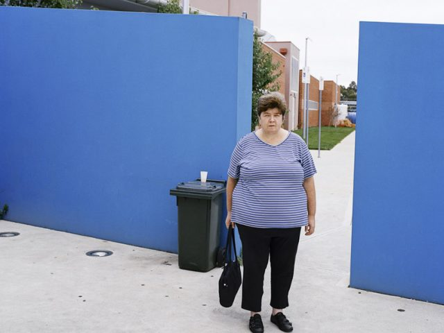 Amy Stein, Woman by Wall