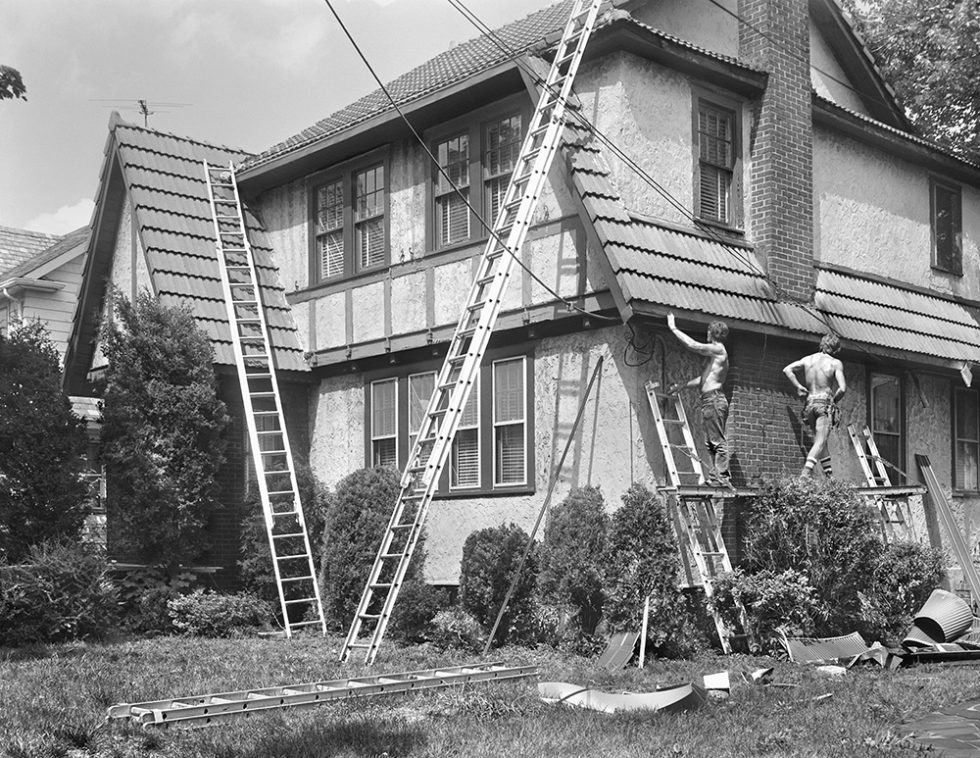 Two Men Repairing House in West Brighton