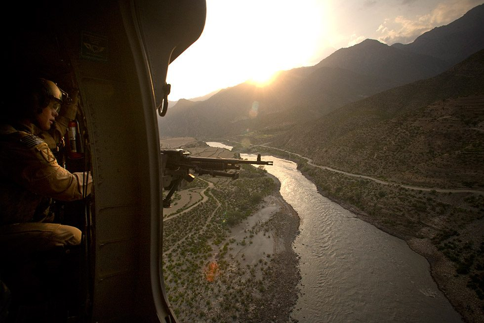A view from the door of a  Blackhawk helicopter over the Kabul River headed to Bagram Airbase from Forward Operating base