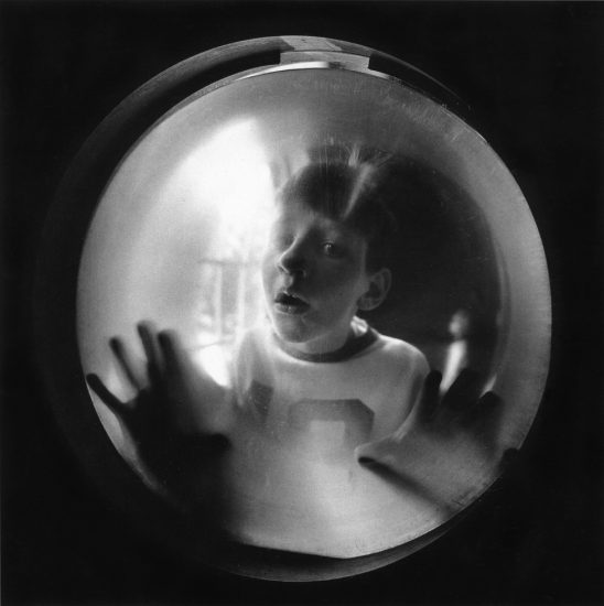 Arthur Tress, Boy Looking Through Window
