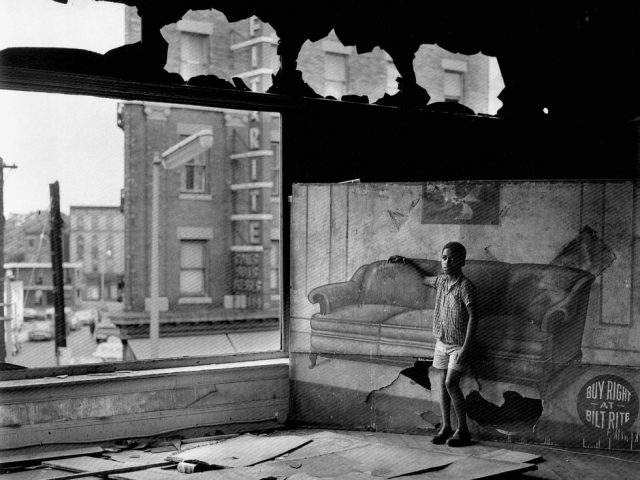Arthur Tress, Boy in Burnt Out Furniture Store