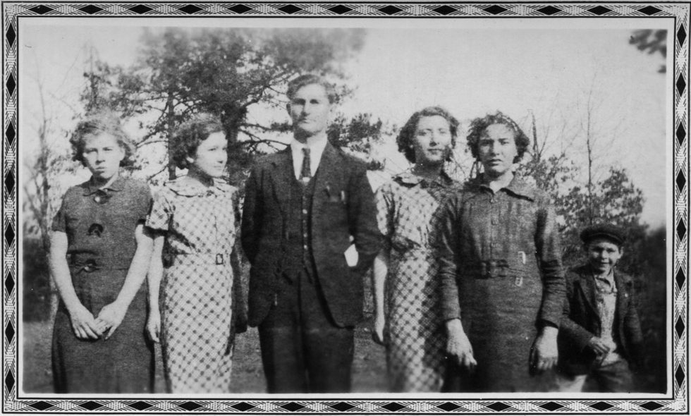 Untitled (Man with four women and one boy)