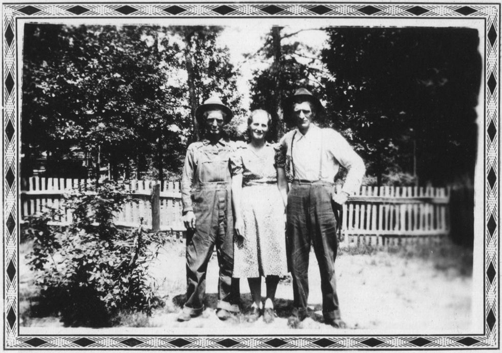 Untitled (Woman with two men)