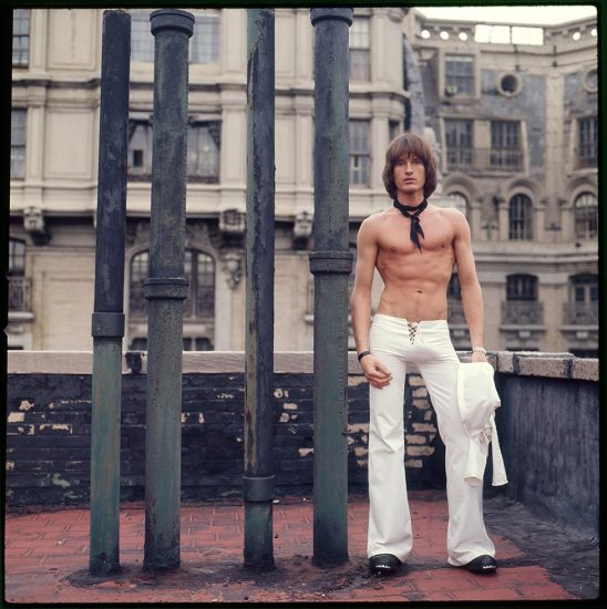 Peter Berlin, Self Portrait on the Roof of the Ansonia (White Pants)