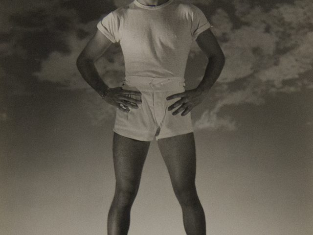 George Platt Lynes, Standing Man with White T-shirt and Shorts (Jack Fontan)