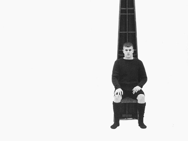 Luke Smalley, Untitled (Man in Black Sitting in Front of Cone II)