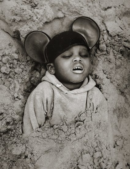 Arthur Tress, Boy in Mickey Mouse Hat, Coney Island, New York