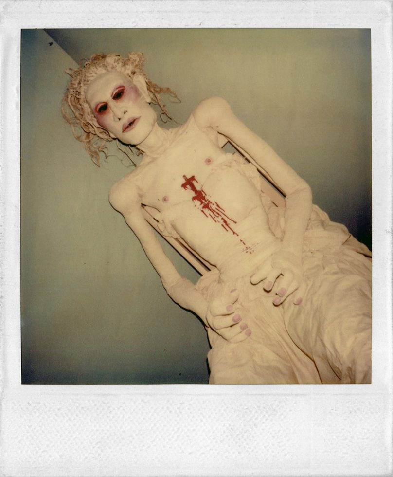 Untitled (Seated Doll with Blood on Chest)