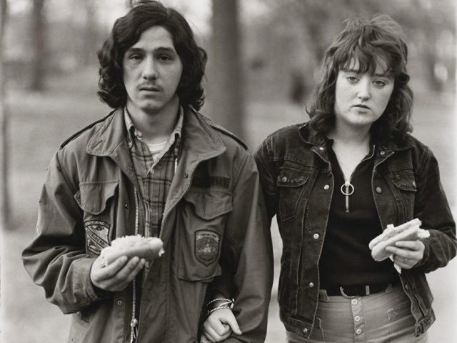 Diane Arbus, A young man and his girlfriend with hot dogs in the park, N.Y.C. 1971