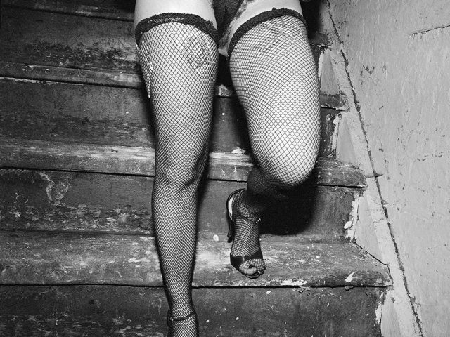 Meryl Meisler, Stacey Walking Down Playmate's Stairs with Tips in Her Stockings