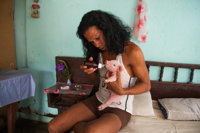Mariette Pathy Allen, Charito at home with one-week-old piglet, Camaguey