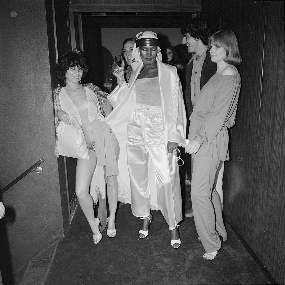 Grace Jones in Hallway with JudiJupiter and Others on Opening Night