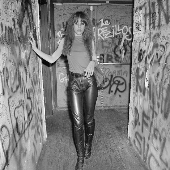 Long Wavy Haired Blonde with Leather Pants Standing in CBGB, Sassy 70s